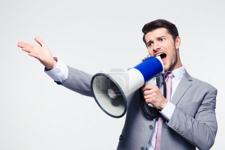 Businessman screaming in loudspeaker