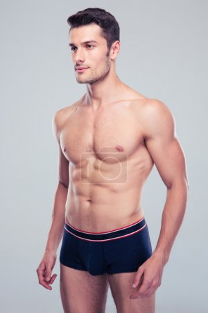 Muscular handsome man looking away