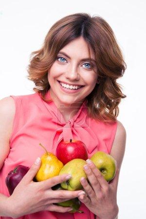 Smiling beautiful woman holding fruits