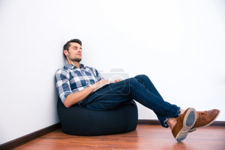 Casual man resting on the bag chair