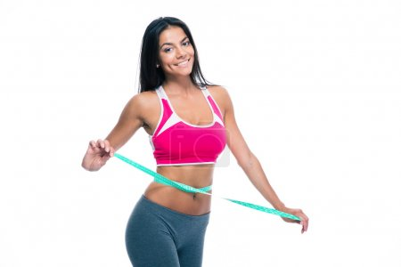 Happy woman with measuring tape