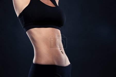 Closeup of a fit woman's abs