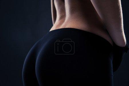 Closeup portrait of a fitness female buttocks