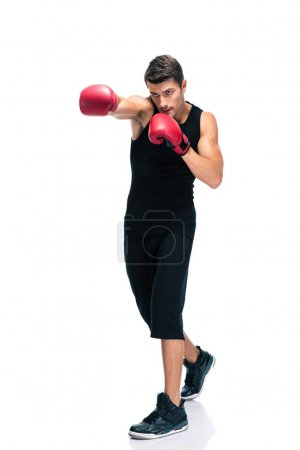 Sports man boxing in red gloves
