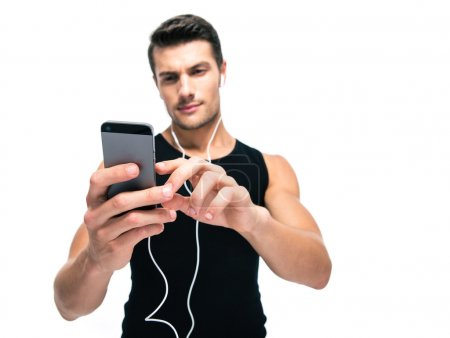 Sports man using smartphone with headphones