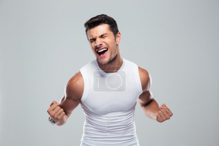 Muscular man celebrating his success