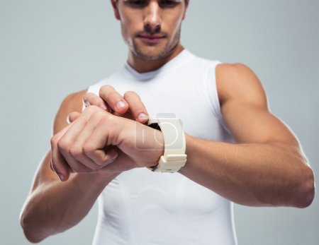 Fitness man using smartwatch