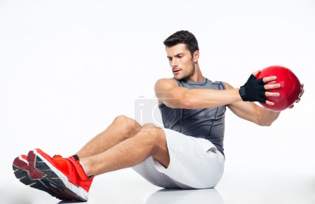 Fitness man working out with fitness ball