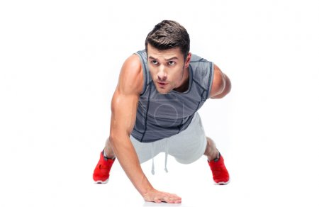 Fitness handsome man doing push ups