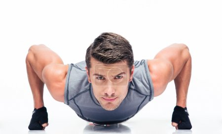 Sports young man doing push ups