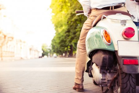 Closeup portrait of a scooter with male legs