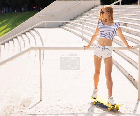 Beautiful female skater looking away