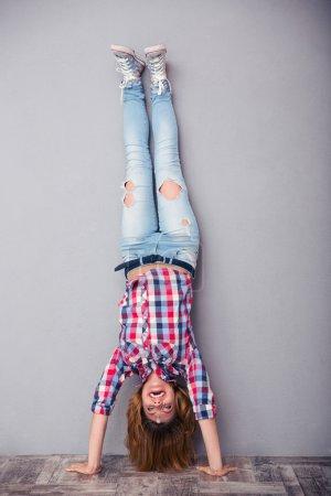 Woman standing upside down