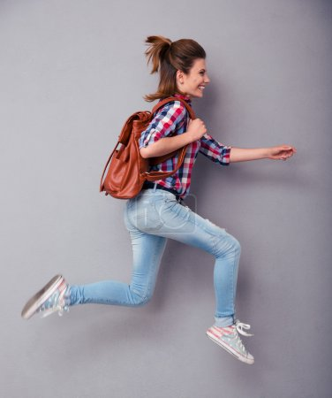Woman with backpack running