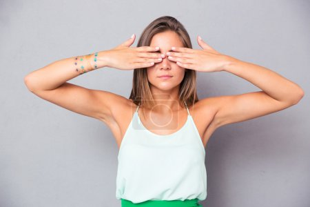 Girl covering her eyes with hands