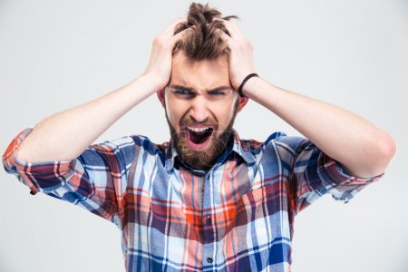 Portrait of upset man screaming