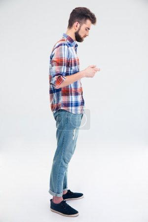 Side view portrait of a man using smartphone