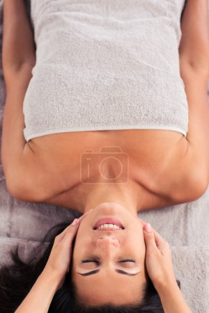 Woman having massage on her face