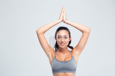 Fitness woman with joined hands over head