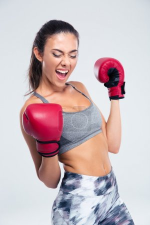 Sports woman with boxing gloves celebrating her victory