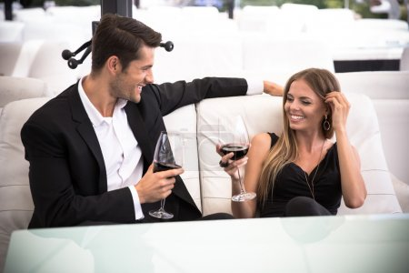 Couple drinking red wine in restaurant