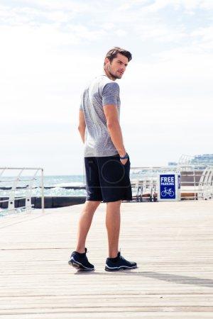 Man in sports wear walking outdoors