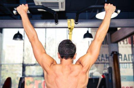 Man tightening on horizontal bar