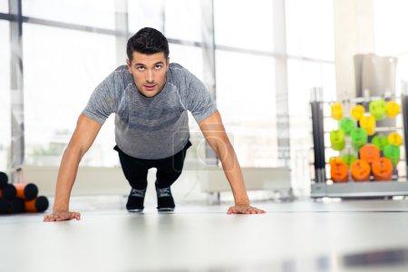 Man doing push-ups in gym
