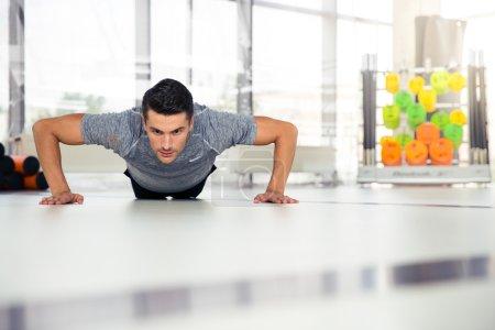 Man doing push-ups at gym