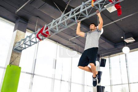 Fitness man tightening in gym