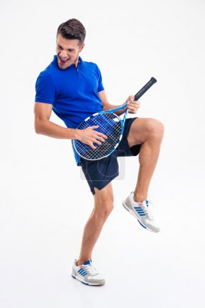 Full length portrait of a male tennis player having fun