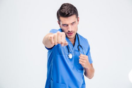Portrait of a male doctor fighting