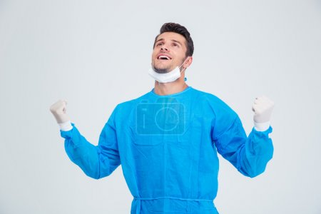 Male surgeon celebrating his success