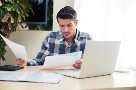 Man working with bills at home