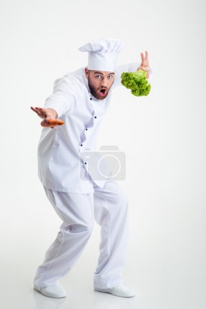Full length portrait of a funny chef cook dancing