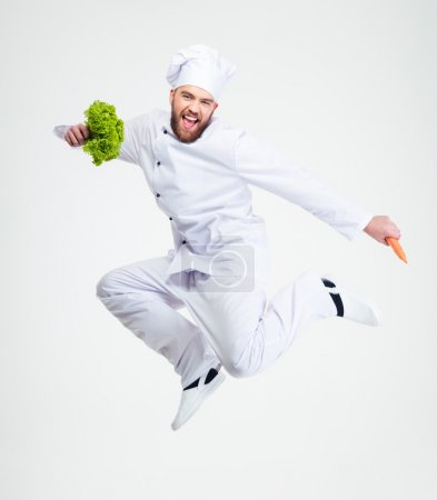 Full length portrait of a cheerful chef cook dancing