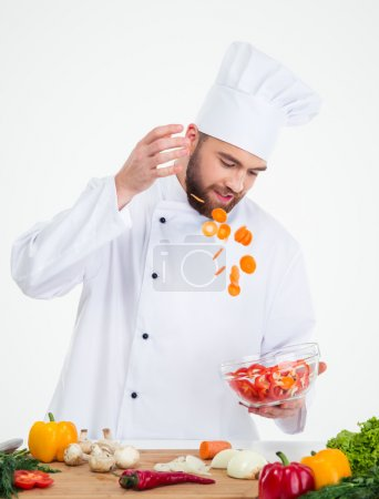 Photo for Portrait of a male chef cook preparing salad isolated on a white background - Royalty Free Image