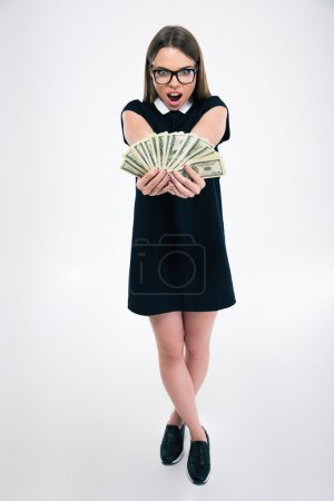 Photo for Full length portrait of a cheerful female student holding dollar bills isolated on a white background - Royalty Free Image