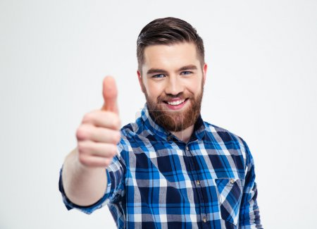 Photo for Portrait of a happy casual man showing thumb up isolated on a white background - Royalty Free Image