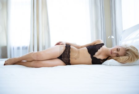 Woman in lingerie sleeping on the bed