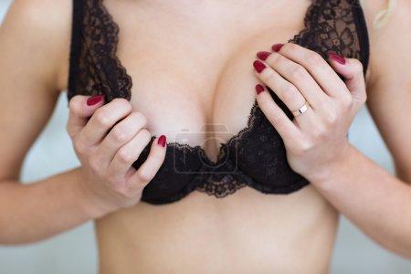 Girl holding her breast