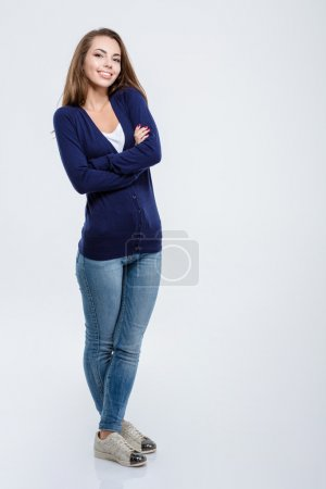 Happy woman standing with arms folded