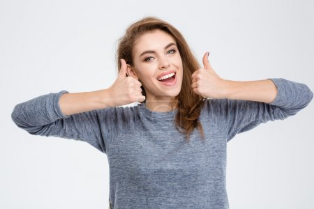 Laughing woman showing thumbs up
