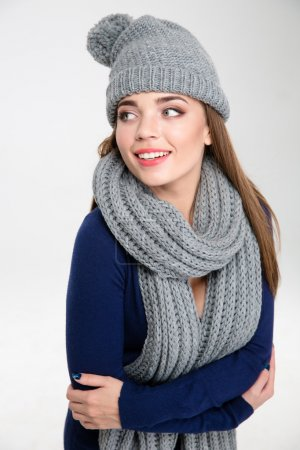 Smiling woman wearing in scarf and hat