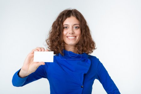Portrait of a smiling woman showing blank card
