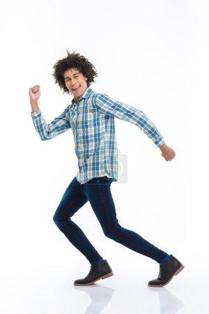 Smiling afro american man running