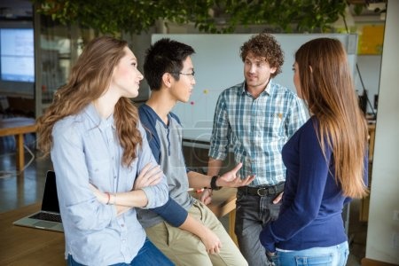 Group of young attractive peopleand discussing new project