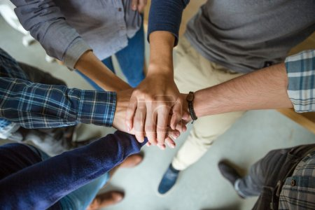 People joining hands together