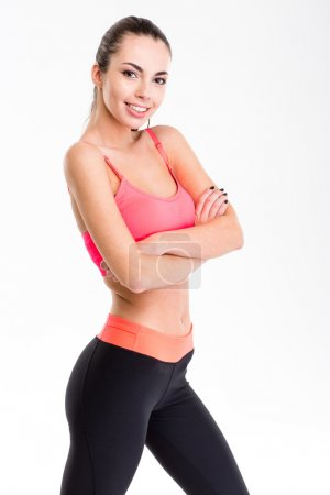 Cute lovely young fitness woman in pink top and bl...