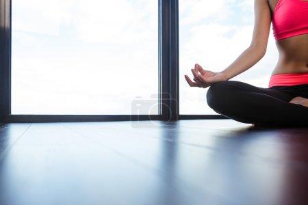 Ssports woman meditating in gym
